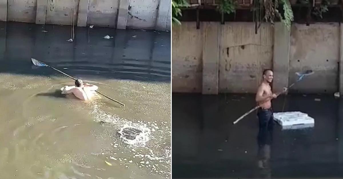 길을 지나가던 한 남성이 갑자기 '오염된 물'에 뛰어든 이유